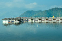 Resort in the lake with mountains background Stock Images