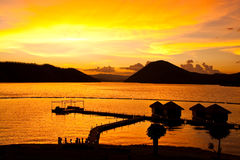 Resort in the lake at sunset Stock Photography