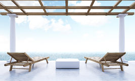Resort lounge area ocean view. Resort lounge area with small table, two wooden chaise lounges, ocean and sky view. 3D Rendering Royalty Free Stock Photography