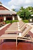 Resort lounge chairs Royalty Free Stock Photo