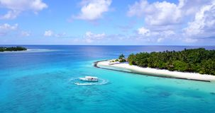 Resort in Maldives white sand beach tropical islands with drone aerial flying birds eye view with aqua blue sea. Water and sunny sky stock video footage