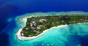 Resort in Maldives white sand beach tropical islands with drone aerial flying birds eye view with aqua blue sea. Water and sunny sky stock video