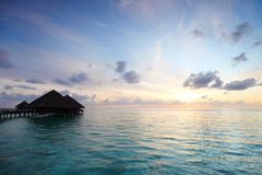 Maldivian houses on sunrise Stock Photography