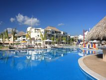 Resort with palm and pool Royalty Free Stock Photography