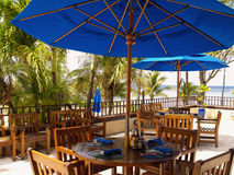 Resort Patio. A patio with dining furniture in a resort by the Caribbean Sea on the St. Croix, US Virgin Islands Royalty Free Stock Image