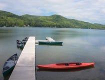 Resort pier on lake Stock Images