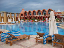 Resort pool. Luxury resort pool before rain Stock Photo