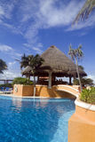 Resort Pool. A resort pool with blue waters and a bar Royalty Free Stock Images