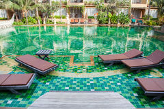 Resort pool. With pool chairs Royalty Free Stock Photo