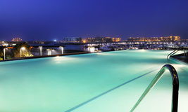 Resort pool and dubai by night Royalty Free Stock Photography