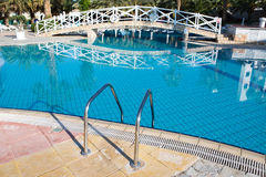 Resort pool with entrance ladder Royalty Free Stock Photo