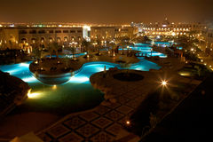 Resort pool at evening Royalty Free Stock Images