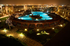 Resort pool at evening Royalty Free Stock Photography