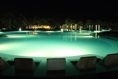 Resort pool at night Royalty Free Stock Images