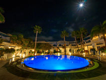 Resort pool at night Stock Images