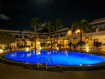 Resort pool at night Royalty Free Stock Photography