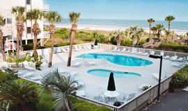 Resort Pool on Ocean Stock Photos