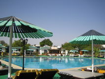 Resort on pool side Royalty Free Stock Images