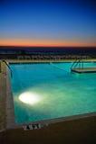 Resort Pool at Sunrise. Resort pool lit up at sunrise Stock Image