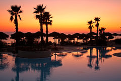 Resort pool at sunset Royalty Free Stock Photography