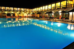 Resort pool and villas - night scene Stock Image