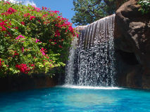 Resort pool and waterfall Royalty Free Stock Photography
