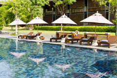 Resort Pool With Beach Chairs And Umbrellas Royalty Free Stock Photos