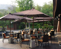 Beautiful tropical resort restaurant patio. Resort restaurant and cafe sitting outdoor. drink your tea or have your meal in an outdoor mountain breeze. Relax and Royalty Free Stock Photo