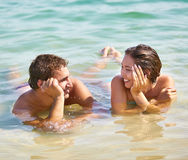 Resort romance. Tanned guy and girl flirting enjoying their resort romance Royalty Free Stock Image