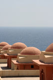 Resort rooftops and red sea Royalty Free Stock Images