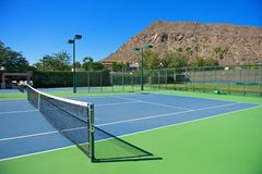 Resort's Blue Tennis Courts Stock Photography