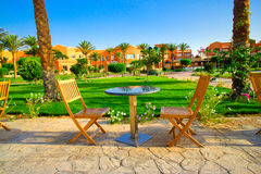 Resort and small lawn with chairs  early morning. Royalty Free Stock Image