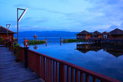 Resort in Southeast Asia. Stilt Bungalows in the early morning at Inle Lake, Myanmar Royalty Free Stock Photo