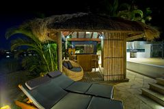 Resort style living with Bali hut with bar and dec Stock Photography