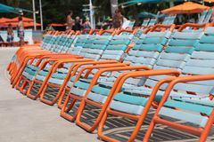 Resort sun lounger chairs in tropical sunshine Royalty Free Stock Photography