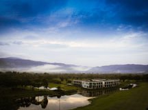 Resort. Sunrise with the mist block Stock Photo