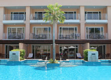 Resort swimming pool. Resort swimming pool in tropical Thailand - travel and tourism Stock Photos