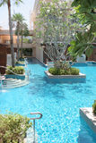 Resort swimming pool. Resort swimming pool in tropical Thailand - travel and tourism Stock Photography