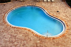 Resort Swimming Pool. A resort swimming pool in sunny south Florida Stock Photo