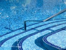 Resort swimming pool. A beautiful resort swimming pool on a summer day stock image