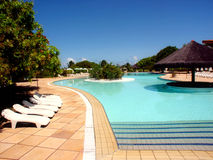 Resort swimming pool. Nice place for a holiday royalty free stock image