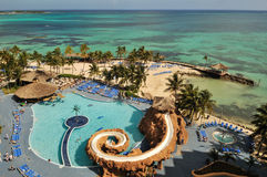 Resort with swimming pool by caribbean ocean. Resort with swimming pool by caribbean sea, nassau, bahamas Stock Photos