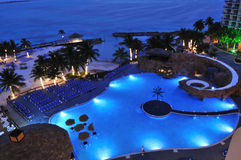 Resort with swimming pool by caribbean sea. Night scene Stock Image