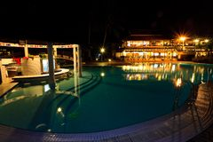 Resort swimming pool at night Royalty Free Stock Photography