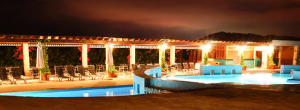 Resort swimming pool at night Royalty Free Stock Photos