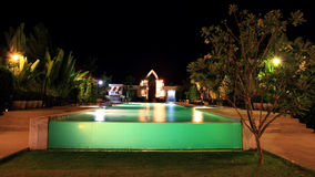 Resort swimming pool at night Royalty Free Stock Images