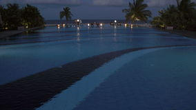 A resort swimming pool at night stock video footage