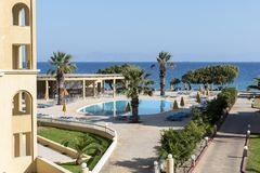 A resort with swimming pool and palm trees on the island of Rhodes. In Greece Royalty Free Stock Images