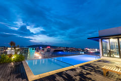A resort swimming pool on the roof at night. Kota Kinabalu city, Malaysia. stock photos