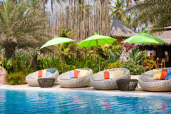 Resort swimming pool, Thailand. Resort swimming pool in tropical Thailand - travel and tourism Stock Photo